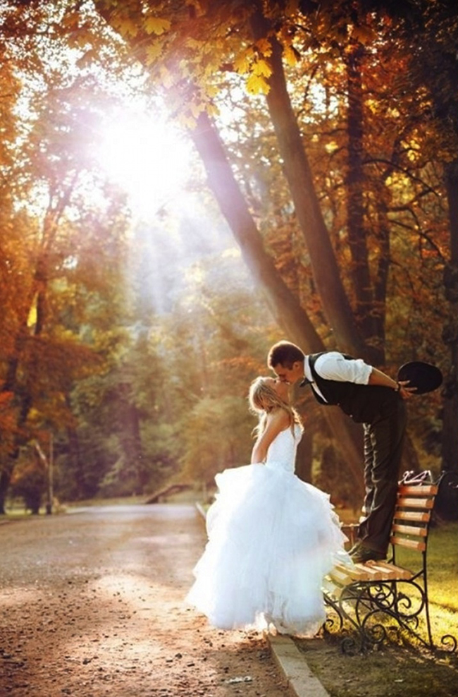 Bride and Groom Fall Wedding Kissing Park Bench