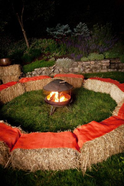 Fire pit with hay bale seating idea for an outdoor fall wedding
