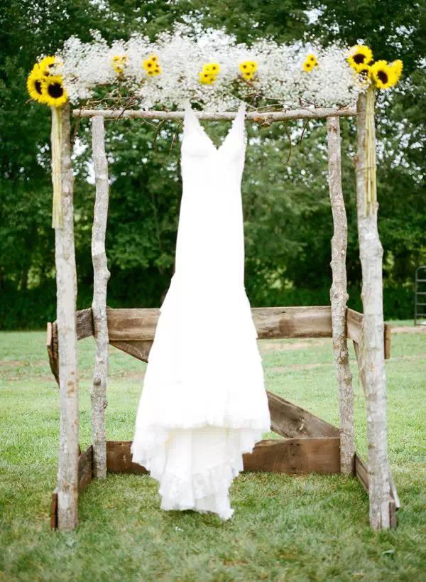 Sunflower Ceremony Arch with Wedding Gown Idea